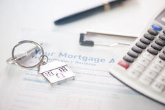 Mortgage loan. Application with calculator and ring key royalty free stock image