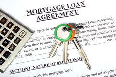 Mortgage loan application form. With home keys and calculator royalty free stock images
