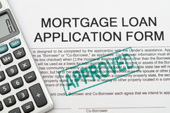 Mortgage loan application form. On approved stamp stock photo