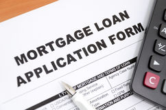 Mortgage loan. Application form and calculator and pen Royalty Free Stock Photos