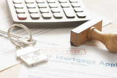 Mortgage loan. Application with rubber stamp stock photos