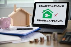 Mortgage Loan approval on mobile phone in a house contract form with approved  home ownership