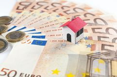 Mortgage and loan concept: paper house on a fifty euros banknote. Paper house on a fifty euros banknote fan: mortgage and loan concept Royalty Free Stock Image