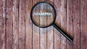 Mortgage loan, magnifying glass Royalty Free Stock Image