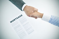 Mortgage loan and man and woman shaking hands, vignetted Stock Photos
