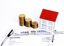 Mortgage Loans concept with close up Loan application form and e. Yeglasses and coins stack and paper house royalty free stock photos