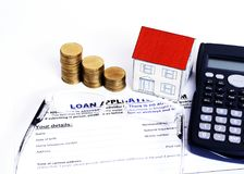 Mortgage Loans concept with close up Loan application form and e. Yeglasses and coins stack and paper house and calculator royalty free stock photo