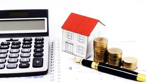 Mortgage loans concept with Fountain pen and money coins stack a royalty free stock photography