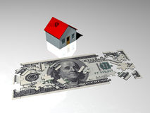 Mortgage payment. A puzzle of a hundred dollars bank note in front of a little house, symbolising the difficulty to pay a mortgage Royalty Free Stock Photos
