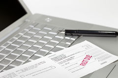 Mortgage payment coupon, pen and laptop Stock Photos