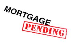 Mortgage Pending. Mortgage heading stamped with a red PENDING rubber stamp royalty free stock photos