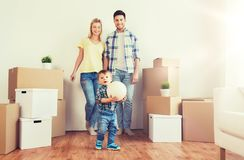 Happy family moving to new home and playing ball Stock Photo