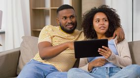Happy couple with tablet pc computer at new home stock footage