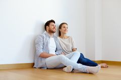 Happy couple at empty room of new home Royalty Free Stock Photos