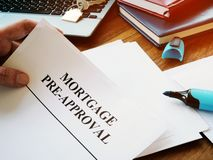 Free Mortgage Pre-approval Documents In The Office Royalty Free Stock Photos - 164904418