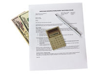 Mortgage Problems. Mortgage modification form with calculator and pen on white background stock photos