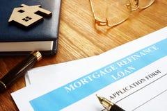 Mortgage refinance loan application form. Mortgage refinance loan application form and pen royalty free stock image