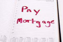 Mortgage reminder. An open diary with a reminder to pay the mortgage Royalty Free Stock Image
