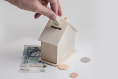 Mortgage saver with british money Royalty Free Stock Photos