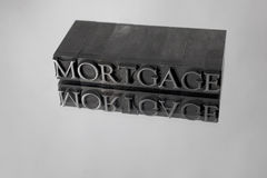 Mortgage spelled with Metal Type Reflection Royalty Free Stock Images