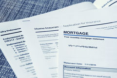 Mortgage Statement. Monthly mortgage statement with home insurance policy papers Stock Image