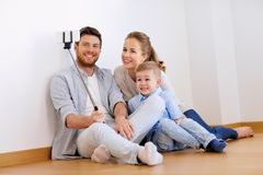 Family taking selfie by smartphone at new home Royalty Free Stock Photo