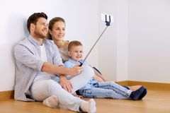 Family taking selfie by smartphone at new home Stock Image