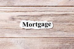 Mortgage of the word on paper. concept. Words of mortgage on a wooden background.  royalty free stock image