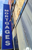 Mortgages. Sign Mortgages on the grungy background Stock Photo