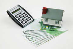 Mortgaging. Mortaging concept with calculator and cash Stock Photo