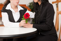 Mortician with client comforting and advising. Undertaker is advising a client for the funeral and is giving her solace Royalty Free Stock Photo