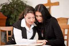 Mortician with client comforting and advising. Undertaker is advising a client for the funeral and is giving her solace Royalty Free Stock Image