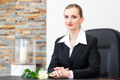 Mortician in her store. Undertaker for the funeral is giving solace in the funeral parlor Royalty Free Stock Images
