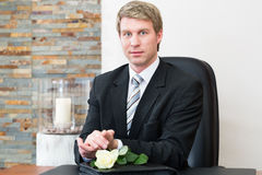 Mortician in his store. Undertaker in his store with a display of coffins Stock Image