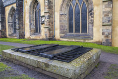 Mortsafe in Greyfriars Cemetery in Edinburgh. An iron cage (known as a mortsafe) covering a grave in Greyfriars Cemetery in Edinburgh, Scotland. Mortsafes were royalty free stock images