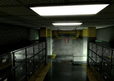 Mortuary dim render. A look down the aisle of fridges of a dimly lit ward in a mortuary with an empty gerney in the distance - 3D render Stock Photo