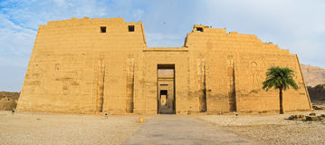 The Mortuary Temple. The massive facade of the Mortuary Temple of Ramesses III, located at archaeological site, named Medinet Habu, Luxor, Egypt royalty free stock images