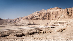 Mortuary Temple of Queen Hatshepsut, Egypt. A long distance view of the Mortuary Temple of Queen Hatshepsut on the west bank of the Nile near to the Valley of stock photo