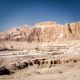 Mortuary Temple of Queen Hatshepsut, Egypt. A long distance view of the Mortuary Temple of Queen Hatshepsut on the west bank of the Nile near to the Valley of royalty free stock image