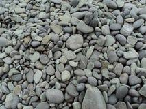 Morze dryluje tło Szarości kamienny tło - otoczak dryluje teksturę Obrazy Royalty Free