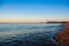 Morze macha przy wschodem słońca Zdjęcia Royalty Free