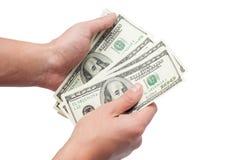 Mãos com dólares Fotografia de Stock
