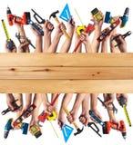 Mãos com ferramentas de DIY. Imagem de Stock Royalty Free