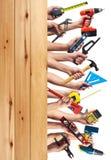 Mãos com ferramentas de DIY. Fotografia de Stock
