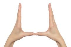 Mãos da mulher que mantêm algo invisível Fotos de Stock