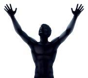 Mãos da silhueta do homem levantadas Fotos de Stock Royalty Free