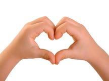 Mãos das crianças em uma forma do coração Fotografia de Stock