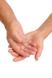 Mãos de mulheres novas e sênior Imagem de Stock