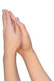 Mãos de uma mulher durante a oração Fotografia de Stock Royalty Free