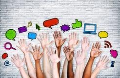 Mãos diversas levantadas com multi ícone Imagem de Stock Royalty Free
